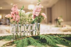 sweet pink green and white bouquets in test tubes
