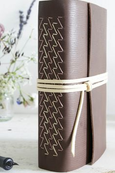 https://flic.kr/p/wovm1C | Close up of leather journal spine by Dani Fox Books