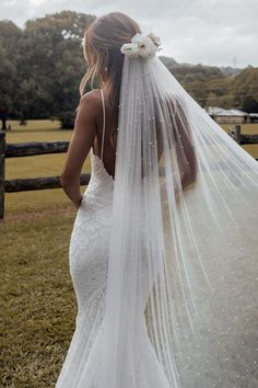 We've really stepped up our veil game with our new favourite Pearly veil. This striking long veil will fall effortlessly over your train. Shop online now! Bride Veil, Wedding Dress With Veil, Wedding Hair Down, Wedding Dress Sleeves, Dream Wedding Dresses, Boho Wedding, Wedding Gowns, Wedding Cakes, Wedding Rings