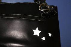 Žvaigždutės ant odinės rankinės
