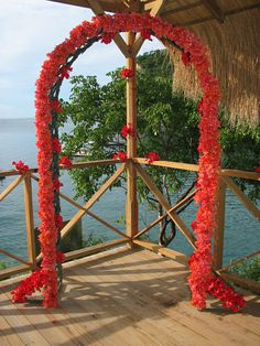 Wedding arch overlooking the tranquil Caribbean Sea, at Anse Chastanet Resort in St Lucia