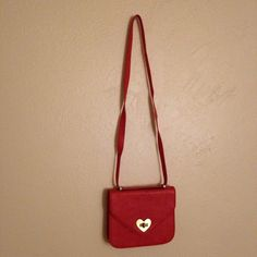 Valentine's heart bag This bag is perfect your your Valentines (or galentines) date! A little wear on the buckle and around the strap. The strap hangs a little weird (as pictured) but I don't think it's a big deal! I have only used this once or twice the wear is from not storing with a lot of care! Forever 21 Bags Crossbody Bags