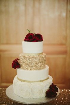 Glam #weddingcake idea - four-tier wedding cake with gold, glitter layer and red roses {Anna Williams Events} #weddingcakes