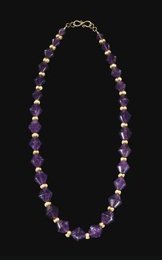 A GREEK AMETHYST AND GOLD BEAD NECKLACE - HELLENISTIC PERIOD, CIRCA 2ND-1ST CENTURY B.C.