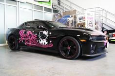 A few days ago, just before the Detroit Auto Show was about to start, we received a photo via twitter of a black Camaro ZL1 with pink Hello Kitty accents. Naturally, we jumped at the chance to say it's a bit of a misfit, an oddity that should never exist.