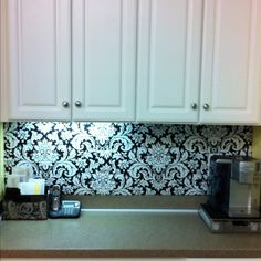 Covered cardboard with fabric (using hot glue) as a backsplash??