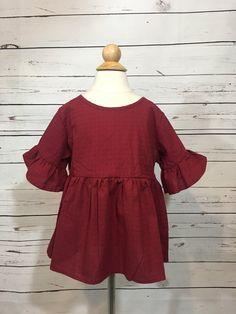 d854607953a48 Beautiful burgandy textured bell sleeved shirt. Top back button closure.  Bell Sleeve Shirt