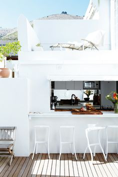 Open air bar & second story lounge space, white & open. I'd love to see the rest of this home
