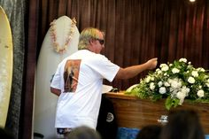 MP's funeral: Andrew 'Andy Mac' McKinnon sprinkles sand on the coffin