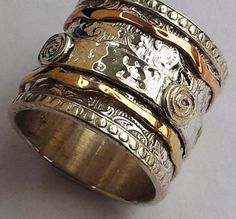 Israeli jewelry spinner ring silver gold