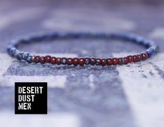 Minimalist bracelet for men with red ceramic tone  and blue ceramic tone seed…