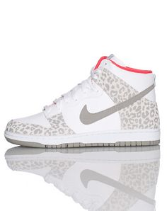 NIKE High top women's sneaker Lace front closure Padded tongue with logo Signature swoosh on sides Candy striper design throughout Cushioned sole