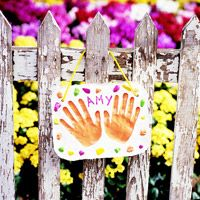 """Handprint Garden Plaque - it would be cute to do """"Amy's Garden"""" and let her help with planting."""