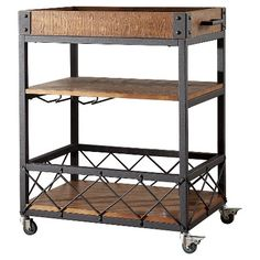 Add serious style to your home bar wit the Ronay Bar Cart. The rustic industrial design of this must-have piece includes black sanded metal supports and naturally finished pine hardwoods for a laid-back look. A removable tray top features handles for easy transportation from the cart. Amenities like wine glass storage, two lower shelves, and locking casters