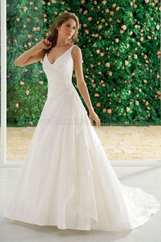 Oh my... very pretty, but no corset closure unfortunately.  Jasmine - style# F912 (available at Elegance by Carbonneau at at Bridal and Gift at Shear Style in Attleboro)