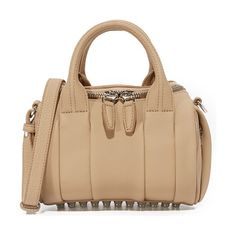 Alexander Wang Mini Rockie Duffel Bag by Alexander Wang. Pebbled leather lends luxe texture to this scaled down Alexander Wang bag. Polished metal studs accent the base. Wrap...