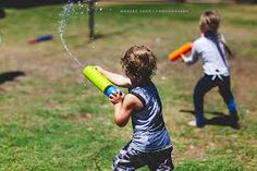 Image result for kids playing with water guns