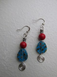 A personal favorite from my Etsy shop https://www.etsy.com/listing/268171167/dangle-earrings-with-glass-red-and-blue