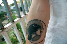 kissing moon tattoo