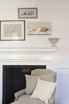 Beautiful Classical white painted fireplace with black painted stone and/or brick designer - Tara Guérard
