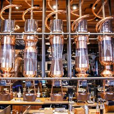 The new Starbucks Reserve Roastery and Tasting Room is both a playground for coffee nerds and a friendly initiation for the average joe-d. Barista, Steampunk Coffee, Coffee Dispenser, Starbucks Reserve, Whisky, Coffee Shop Design, Bar Interior, Espresso, How To Make Coffee