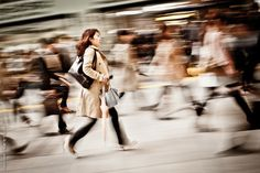 PANNING  Rush Hour Rush by Dreycat    A woman rushes to get to work during Tokyo morning rush hour.    Tip. The key to getting a shot like this is to use panning, where the camera is set to a low shutter speed and you track the movement of the person with your camera. You'll often need a few attempts to get a good shot