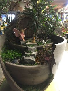 Fairy watching over the rabbits by Kristin Middleton #colonialgardenskc
