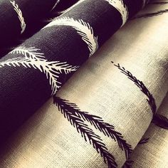 Dhinawan (emu feather) print on black and white linen tea towels by Gaawaa Miyay.