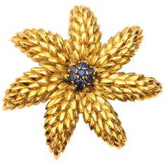 For Sale on - Retro Tiffany and Co. Brooch - Yellow Gold, Blue Sapphires The textured petals have a lovely patina. 7 Blue Sapphires form the flower center. Antique Brooches, Gold Brooches, Gold For Sale, Flower Center, Diamond Brooch, Tiffany And Co, Blue Sapphire, Garnet, 18k Gold