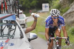 """Tour de France 2010 """"Sylvain Chavanel gets a cooling spray by his team director during stage seven between Tournus and Station des Rousses July 10. (AP Photo/Christophe Ena"""""""