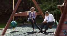 President Obama talks with his daughter Malia on the swing set outside the Oval Office