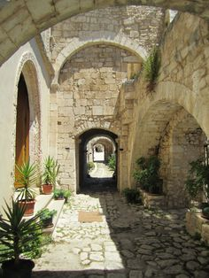 The courtyard of the Abbey of St. Mary of Pulsano in Puglia. Set on a rocky cliff overlooking the Adriatic sea with a venerated cave.   www.traveladept.com