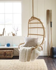 Save floor space in your living room by installing a hanging chair.