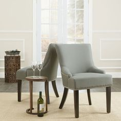 @Overstock - Loire Chairs (Set of 2) will work well with a wide range of dining and accent chair styles. Chairs features a solid beech wood frame and legs.http://www.overstock.com/Home-Garden/Loire-Grey-Linen-Nailhead-Dining-Chairs-Set-of-2/6531682/product.html?CID=214117 $274.99