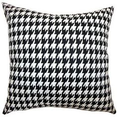 Add a pop of pattern to your sofa, bed, or windowseat with this charming black and white pillow.  Product: PillowConstruction Material: Cotton and down fillColor: BlackFeatures:  Insert includedHidden zipper closureMade in the USA Dimensions: 18 x 18