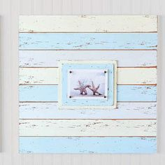 Distressed picture frames in beachy colors for table tops and walls.