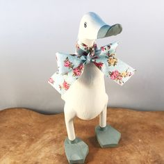 This wooden duck is hand painted in original colour Annie Sloan chalk paint with duck egg blue feet and beak. With a matching bow this duck will look lovely in any room in your house Duck Ornaments, Ducks, Roots, Bamboo, Etsy Shop, Handmade Gifts, Diy, Home Decor, Kid Craft Gifts