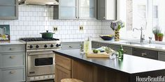 """Designer SuzAnn Kletzien transformed this Chicago kitchen with new fixtures and mixed metals, unifying the space with gray and white, as seen in the backsplash — plus hints of brass.  She swapped in an island for the existing peninsula, but the appliances stayed put. """"That way we could afford to splurge on a wine refrigerator,"""" says Kletzien."""