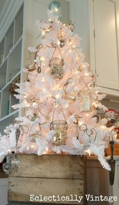 white christmas tree with gold and white ornaments