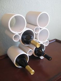 a wine holder made out of pvc pipes! so easy and definitely a cool idea i would spray paint it another color though