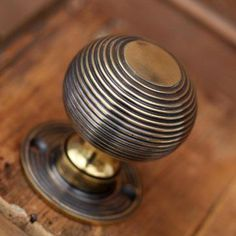 Willow and Stone brass beehive door knobs with an aged finish perfect for a front door providing good grip. Available from Willow & Stone - will dispatch worldwide.
