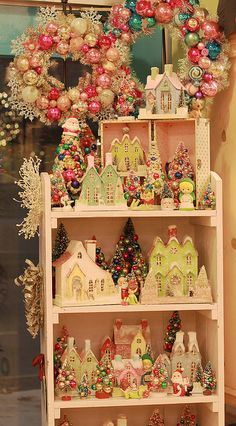 Christmas houses and vintage ornament wreaths