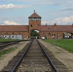 The entrance to Birkenau today. Auschwitz-Birkenau concentration camp was a network of concentration and extermination camps operated by the Third Reich. It is located near the Polish town of Oświęcim which is about 50 km west of Kraków