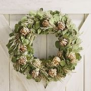 Our one-of-a-kind handcrafted wreath featuresfarm-raised botanicals gently air-dried to preserve their peak beauty. Composed of artichokes, leaves, wild grains and grasses and nestled in a custom wooden crate for storage and display, it's perfect for years of indoor or covered outdoor use.