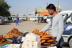 Young Iraqi man sells sweets in Baghdad Iraq Baghdad Photography Rasoul Ali