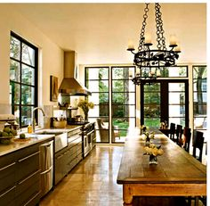 Kitchen/great room inspiration: dark window frames with white moulding