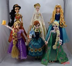 Here are my favorite 16-17 inch dolls that were released in 2015. All these dolls are by the Disney Store, except for the DL60 LE Aurora Doll, by Disney Parks. All are limited edition, except for the singing Rapunzel. Top row - D23 LE 500 Red Jasmine 17'' Doll - Platinum LE 500 Wedding Cinderella 17'' Doll - DL60 LE 3000 Blue Aurora 17'' Doll Bottom row - Rapunzel Deluxe Feature Singing 16'' Doll - Frozen Fever LE 5000 Anna and Elsa 17'&apos…