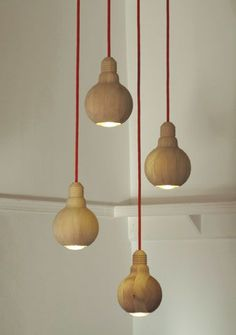 woodturned lamps | Wood turned lamp shades that look like light bulbs.