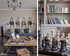 Dans le salon de Ludivine Degas, propriétaire de la boutique de décoration 'La Maison Poétique' à Bordeaux, tabouret 'Zara Home', table basse 'AM.PM.', bougies 'Ikea' et des cadres photos 'Côté Table'. Canapés et miroirs 'Zina', suspension 'Côté table', grand échiquier 'Flamant' en bois massif