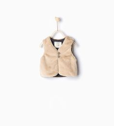 Image 1 of Faux fur waistcoat with leather effect detail from Zara